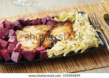 swordfish steak with beetroot - stock photo