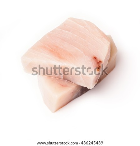 Swordfish ( Xiphais gladius) steak portion uncooked and isolated on a white studio background. - stock photo