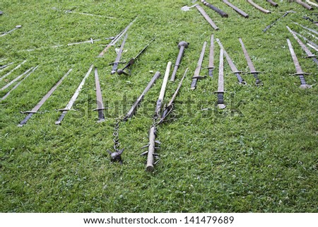 Swords and medieval weapons of war historical reenactment, event - stock photo