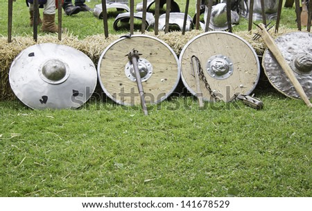 Swords and shields in medieval camp, historical reenactment of Spain - stock photo
