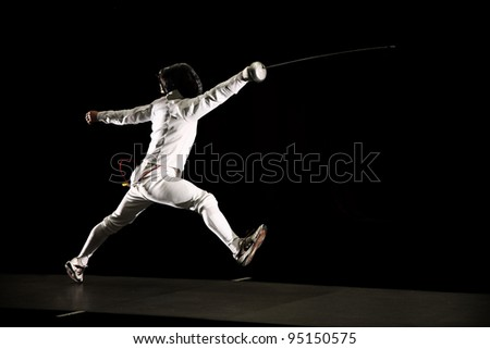 swordsman isolated on black background - stock photo