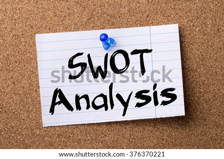 SWOT Analysis - teared note paper  pinned on bulletin board - horizontal image - stock photo
