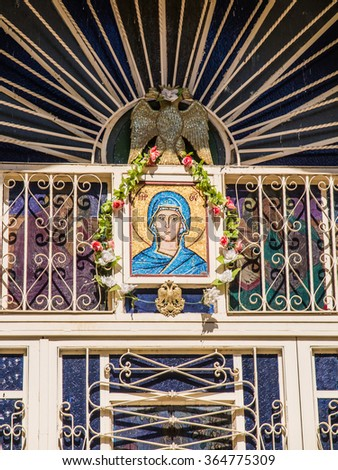 Sychar, Israel, July 11, 2015.: The icon of the Virgin Mary and the dove symbolizing the Holy Spirit over the entrance to the Greek orthodox church in place of the biblical Jacob's well in Sychar - stock photo