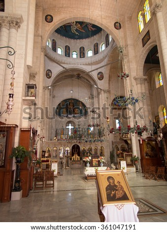 Sychar, Israel, July 11, 2015.: The interior of the church in Sychar in Samaria with the image of Jesus with the Samaritan woman at the well.