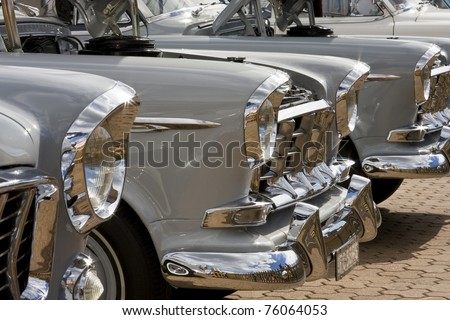 SYDNEY - APRIL 22: The fronts of lined-up vintage Holden cars shine in sunlight in the car exhibition stall at the Royal Easter Show in Sydney Olympic Park Showground on April 22, 2011 - stock photo