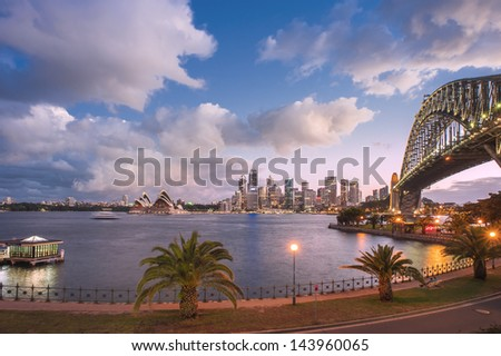SYDNEY - APRIL 17: View of Sydney and the Harbor on April 17, 2011 in Sydney, Australia. Over 10 millions tourists visit Sydney every year, making Sydney one of the world's top tourist destinations. - stock photo