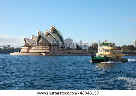 SYDNEY - AUGUST 18: Ferry passes by Sydney Opera House on a sunny day of August 18, 2008 in Sydney, Australia. - stock photo