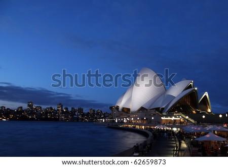 SYDNEY - AUGUST 7: Sydney Opera House at twilight is one of Sydney's most famous landmarks. August 7 2010 in Sydney, Australia. - stock photo