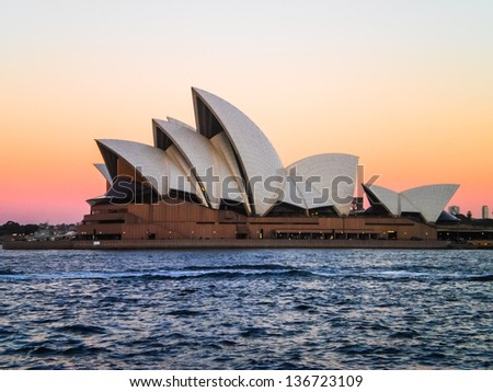 SYDNEY -AUGUST 25 :Sydney opera house  on pink sky evening view on 25 August 2011 .It was designed by Danish architect Jorn Utzon . - stock photo