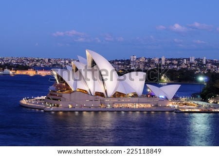 SYDNEY - August 29: The sails of the Sydney Opera House beam white at dusk on August 29, 2010 in Sydney, New South Wales, Australia.  - stock photo