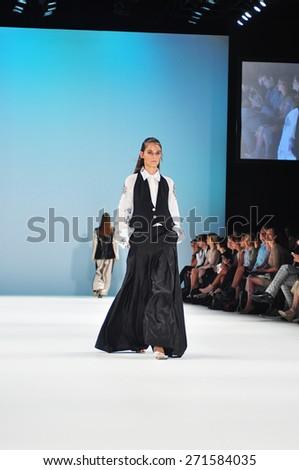 SYDNEY AUSTRALIA - 16 APRIL 2015: Cynthia Fransisca collection presented by Raffles International Showcase fashion show runway at Mercedes Benz Fashion Week in Carriageworks Sydney Australia. - stock photo