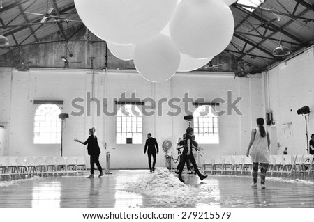 SYDNEY AUSTRALIA - 15 APRIL 2015: Preparation for Jennifer Kate leather female clothes collection fashion show runway at Mercedes Benz Fashion Week in Carriageworks Sydney Australia.  - stock photo