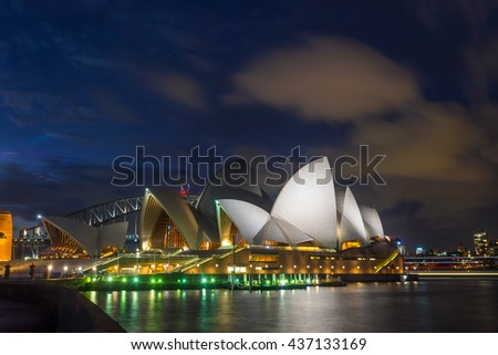 SYDNEY, AUSTRALIA - APRIL 22: View on Sydney opera and Harbour bridge at night, long exposure. Opera is one of most recognizable buildings of 20th century. April 2016