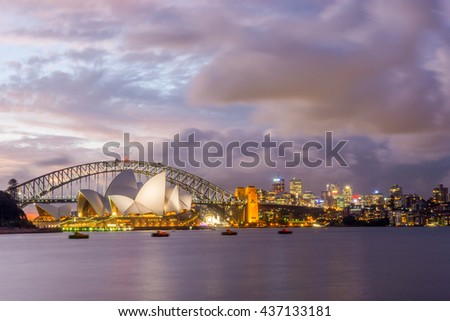 SYDNEY, AUSTRALIA - APRIL 20: View on Sydney opera and Harbour bridge in purple sunset, long exposure. April 2016