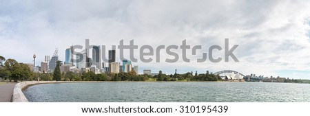SYDNEY, AUSTRALIA - Aug. 5, 2015: Sydney Opera House and CBD skyscrapers viewed from Royal Botanic Gardens - stock photo