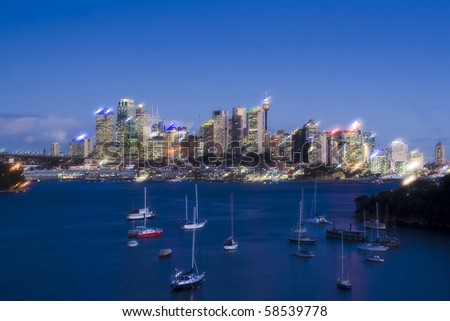 sydney australia CBD night soft effect image harbour bay yachts and skyscrapers highlighted - stock photo