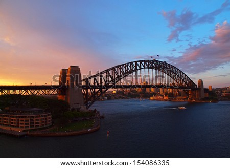 SYDNEY, AUSTRALIA - CIRCA NOVEMBER 2012 - The Sydney Harbour Bridge at sunset.  It is the tallest steel arch bridge in the world. - stock photo