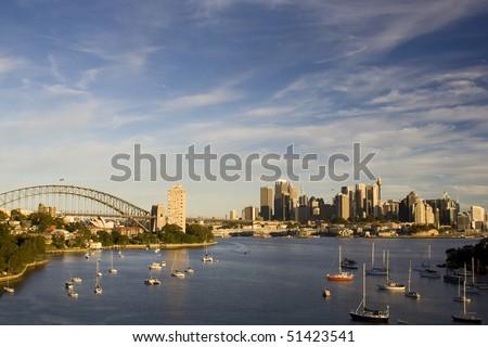 Sydney Australia city and bridge bay yacht day panoramic sunset colorful view - stock photo