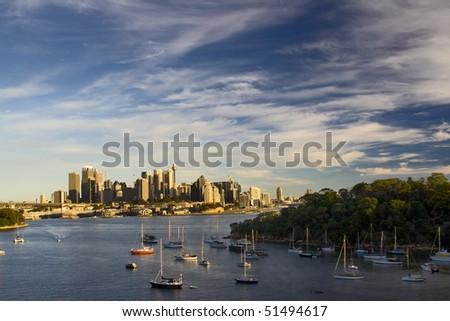 Sydney Australia city and bridge bay yacht evening sunset view from Waverton - stock photo