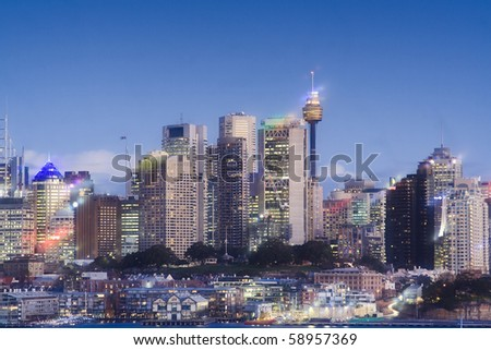 sydney australia city CBD close up crop front view sunset soft effect blue sky skyscrapers towers office buildings - stock photo
