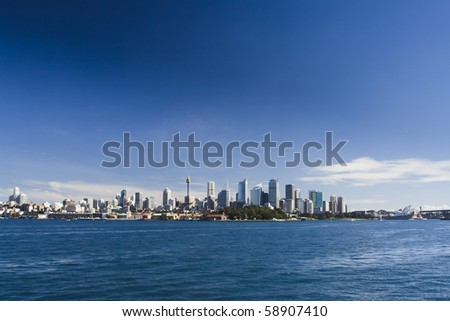 sydney australia city central business district royal botanic garden bay blue skyline distant view - stock photo