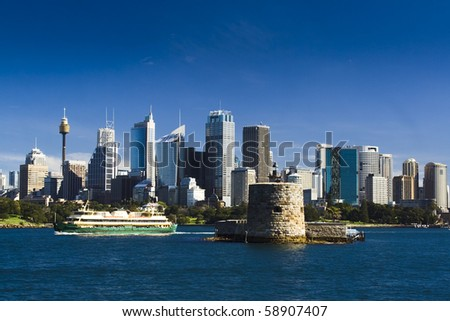 sydney australia city central business district view from harbour ferry over bay blue skyline fort denison - stock photo