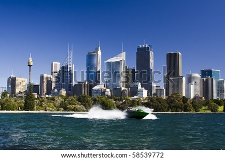 sydney australia city central business district view from royal botanic garden over bay blue skyline jet boat - stock photo