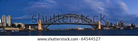 sydney australia city north and CBD view from BLue point dusk lightning illuminated bridge, luna park, harbour - stock photo
