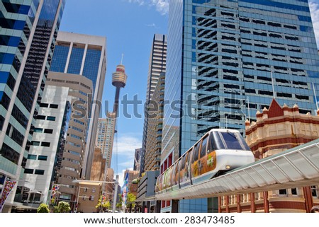 SYDNEY, AUSTRALIA - Dec 27: A monorail runs above the public street in Darling Harbour area of Sydney on December 27,2011 in Sydney. The monorail is a unique public transport system in Sydneys CBD.  - stock photo
