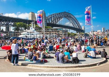 SYDNEY,AUSTRALIA-DEC 31, 2014: People near Harbour bridge on Dec 31, 2104 in Sydney,Australia.News years eve celebrations at Harbour Bridge,attended by almost 1 Million people from all over the world. - stock photo