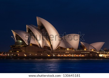 SYDNEY, AUSTRALIA- DEC 14: The Sydney Opera House on December 14th, 2012 in Sydney, Australia. The Opera House was made a UNESCO World Heritage Site in June 2007 and is Australia most famous landmark. - stock photo