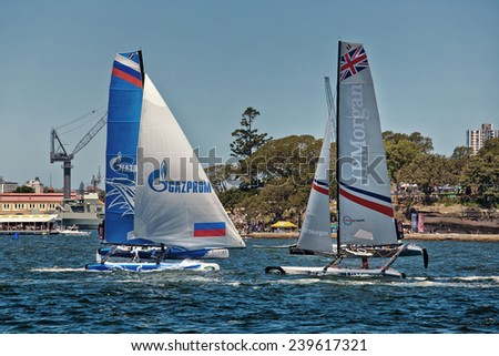 SYDNEY, AUSTRALIA - DECEMBER 14,2014: Catamarans racing in the Extreme Sailing Championship. The boats can reach 30 knots, often with one hull high out of the water.