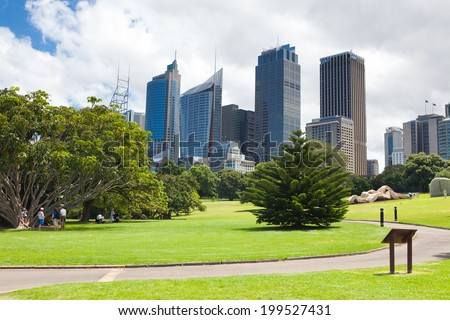 SYDNEY, AUSTRALIA - DECEMBER 18, 2012; Early morning parkscape view of the CBD Sydney. The park is Parade Ground, Royal Botanic Gardens on Dec. 18 2012