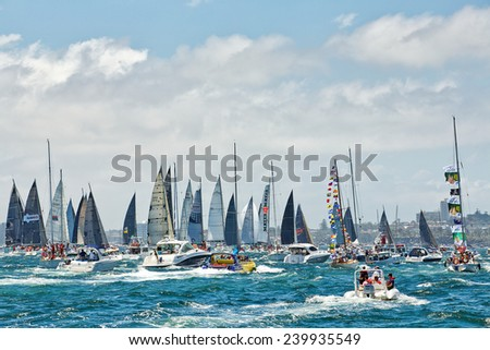 SYDNEY,AUSTRALIA - DECEMBER 26,2014: Motor boats follow yachts competing in the 70th Sydney to Hobart yacht race. It is one of the world's greatest yacht races. - stock photo