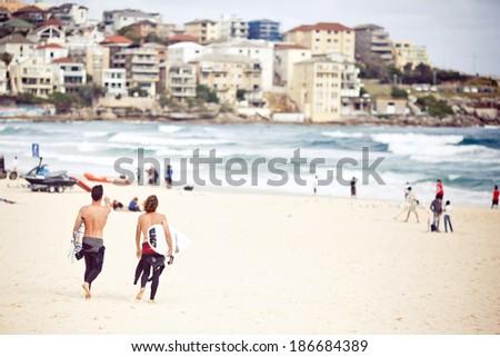 SYDNEY, AUSTRALIA - DECEMBER 27, 2102: Surfers at Bondi Beach in Sydney on December 27, 2012, Australia.  - stock photo