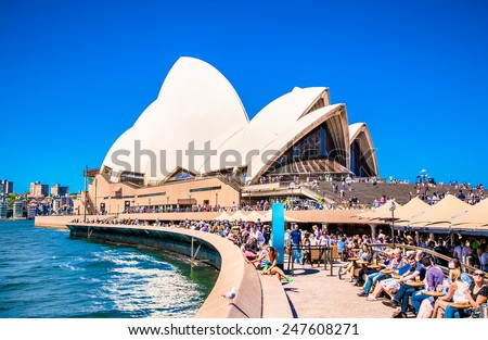 SYDNEY, AUSTRALIA - DECEMBER 21, 2014: The Iconic Sydney Opera House is a multi-venue performing arts centre also containing bars and outdoor restaurants. December 21, 2014 in Sydney, Australia. - stock photo