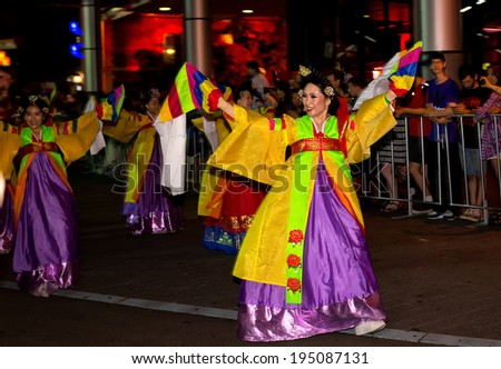 SYDNEY, AUSTRALIA - FEBRUARY 2, 2014: Dancers in a city centre parade celebrate Chinese New Year . Organisers estimate that 100,000 people lined the route to welcome in the year of the horse. - stock photo