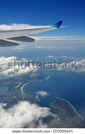 SYDNEY, AUSTRALIA - FEBRUARY 13, 2012: Flying Garuda Airlines over the South Sydney coast line. - stock photo