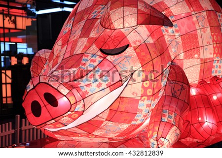 SYDNEY, AUSTRALIA - 7 FEBRUARY, 2016; The Pig one of the Chinese zodiac signs on display in Pitt Street Mall for Chinese New Year Celebrations.  The pig is associated with sleeping, eating, laziness,