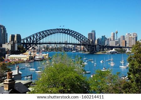 SYDNEY, AUSTRALIA - FEBRUARY 4: View on Sydney City Center, Harbor Bridge, Luna Park, boats and yachts from Lavender Bay. Sydney, Australia - Feb. 4, 2013  - stock photo