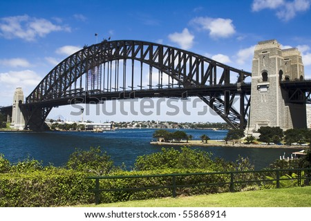 Sydney australia harbour bridge view from milsons point park bright summer day green plants and blue sky - stock photo