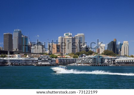 sydney australia harbour view on city CBD the Rocks, skyscrapers and fast running motor boat