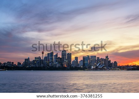 Sydney, Australia - Jan 17, 2016: View of the Opera House and City Sydney Tower, the most iconic landmarks in Sydney, Australia on sunset times.