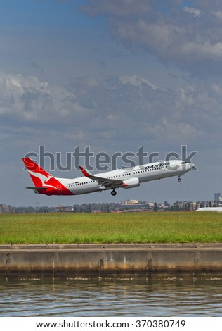 SYDNEY,AUSTRALIA - JANUARY 31,2016: A Boeing 737 of QANTAS takes off from the city's airport. The airport is located 5 miles south of the city centre. - stock photo