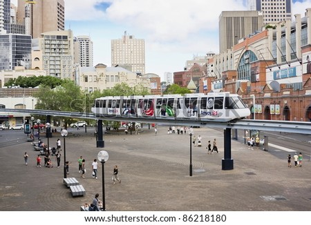 SYDNEY, AUSTRALIA - JANUARY 10: A monorail runs above the public square adjacent to Paddy's Market on January 10, 2011 in Sydney. The monorail is a unique public transport system in Sydney's CBD. - stock photo