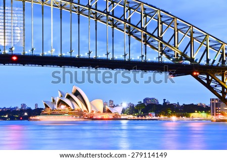 Sydney, Australia - January 24: Sydney Harbor Bridge and Opera House at twilight on January 24, 2015 in Sydney, Australia.  - stock photo