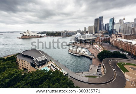 SYDNEY, AUSTRALIA - JANUARY 8, 2014: Sydney Harbour with Sydney Opera House. The Sydney Opera House hosts over 1,500 performances each year that are attended by approximately 1.2 million people. - stock photo