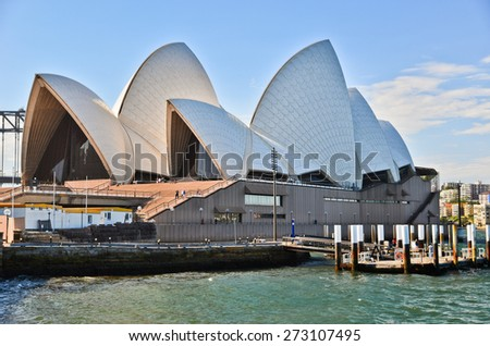 Sydney, Australia - January 23: Sydney Opera House in a sunny day on January 23, 2015 in Sydney, Australia. The Sydney Opera House is one of the most famous performing arts centers in the world. - stock photo
