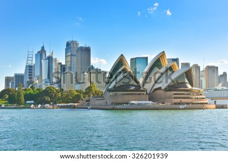 Sydney, Australia - January 25: Sydney skyline and Opera House in the afternoon on January 25, 2015 in Sydney, Australia. The Sydney Opera House is one of the most famous buildings in the world. - stock photo