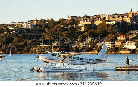SYDNEY,AUSTRALIA - JULY 27,2014: A Cessna 208 seaplane taxis out of Rose Bay for takeoff. - stock photo